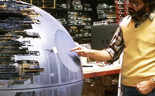 A young Darth Tyranus views a model of the first Death Star on Geonosis