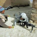 Great Moments in Photography: Local offers soldier a glass of urine