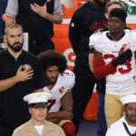 Kaepernick's out of control afro kneels for anthem